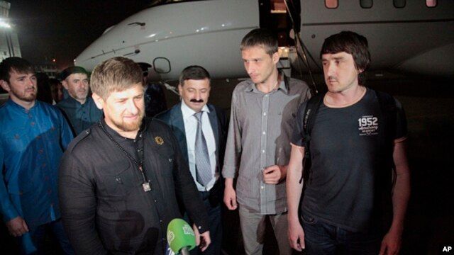 From left: Chechen regional leader Ramzan Kadyrov accompanied by Russian journalists Oleg Sidyakin and Marat Saichenko addresses media following release from captivity in Ukraine, Grozny, Chechnya, May 25, 2014.