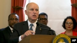 FILE - California Gov. Jerry Brown discusses climate change at a news conference in Sacramento, California, June 13, 2017.