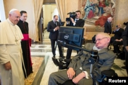 FILE - Pope Francis greets Stephen Hawking, theoretical physicist and cosmologist, during a meeting with the Pontifical Academy of Sciences in Vatican, Nov. 28, 2016.