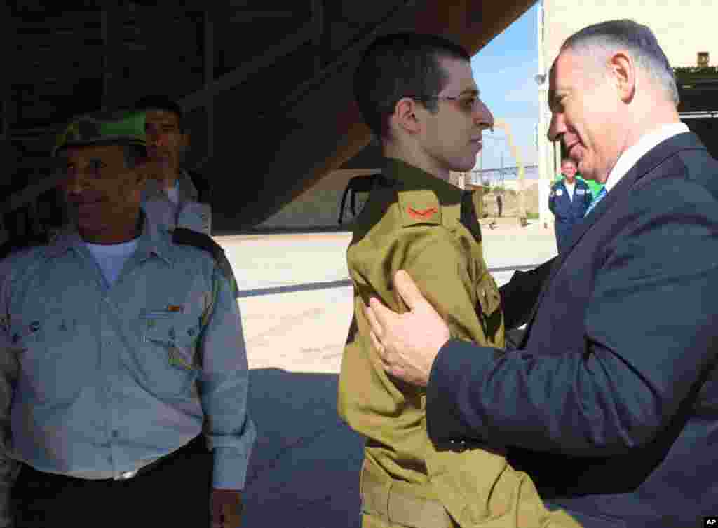 October 18: Israel Prime Minister Benjamin Netanyahu greets Gilad Shalit at Tel Nof air base in central Israel. Israeli soldier Shalit returned home on Tuesday after five years in captivity. The hundreds of Palestinian prisoners exchanged for him were gre