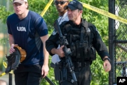 A member of the Congressional Republican softball team is allowed to leave the scene of a multiple shooting involving House Majority Whip Steve Scalise of La., June 14, 2017, in Alexandria, Va.