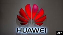 FILE - The Huawei logo is seen at a Huawei store at a shopping mall in Beijing, July 4, 2018. The Chinese-owned telecommunications giant has been blocked from rolling out Australia's 5G network because of security concerns.