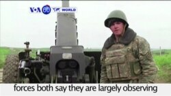 VOA60 World PM - Azerbaijani and Armenian forces both say they are largely observing a cease-fire