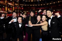 "Bong Joon Ho and the cast of ""Parasite"" pose at the 92nd Academy Awards in Hollywood, Los Angeles, California, U.S., February 9, 2020."