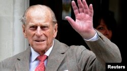 Britain's Prince Philip waves to members of the media as he leaves the King Edward VII Hospital in London June 9, 2012. (File)
