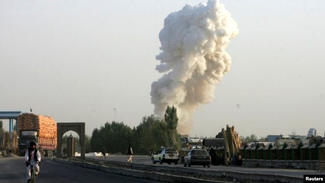 Smoke rises from the site of a bomb attack on a base operated by Polish and Afghan forces in Ghazni province, Afghanistan, Aug. 28, 2013.