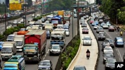 Gridlocked traffic is seen in a busy street, estimated to cause heavy losses in wasted fuels and working hours, and in cargo and passenger transport losses in Jakarta, Indonesia (file photo)