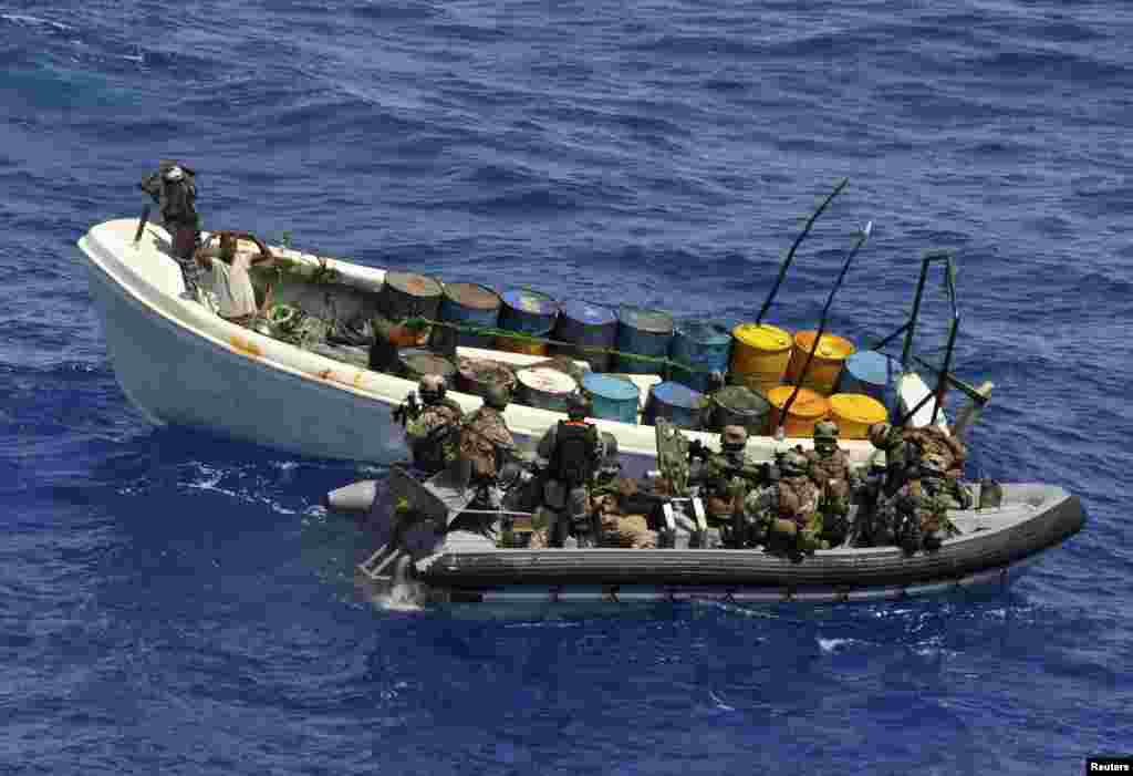 German marine forces as part of the European Union Naval Force Operation Atalanta, intercept a ship with suspected pirates off the coast of Tanzania, November 4, 2011.