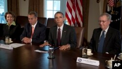 President Barack Obama, joined by (L-R) House Minority Leader Nancy Pelosi, House Speaker John Boehner and Senate Majority Leader Mitch McConnell, speaks to the media after a meeting at the White House, Jan. 13, 2014.