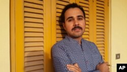 """FILE - Egyptian author Ahmed Naji poses for a photo in Cairo, Egypt, in this undated image. Naji was sentenced to two years in jail Feb. 20, 2016, by a Cairo appeals court for publishing a sexually explicit excerpt of his novel that prosecutors said violated """"public modesty."""""""