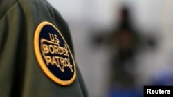 FILE - A logo patch is shown on the uniform of a U.S. Border Patrol agent.