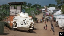 FILE - A U.N. armored personnel carrier stands in a camp for the internally displaced in Juba, South Sudan, July 25, 2016. The country's festering civil war risks spiraling into genocide, the U.N.'s special adviser on the prevention of genocide, Adama Dieng, has warned.