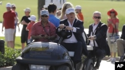 FILE - Donald Trump drives himself around a golf course in Doral, Florida, March 6, 2016. Even thought the White House released no detailed accounting of much of President Trump's schedule over the weekend, according to a source, he played 18 holes Saturd