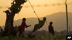 Pakistani children play on the outskirts of Islamabad, Pakistan in 2013 file photo. (AP Photo/Anjum Naveed)