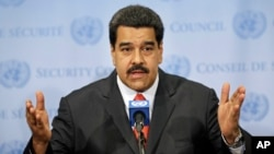 FILE - Venezuelan President Nicolas Maduro speaks to reporters at U.N. headquarters in New York, July 28, 2015.