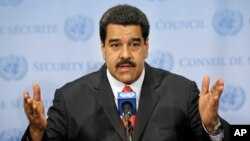 FILE - Venezuelan President Nicolas Maduro speaks to reporters at U.N. headquarters in New York, July 28, 2015.