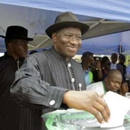 Nigerian President Goodluck Jonathan casts his ballot in his home village of Otuoke, Bayelsa state.