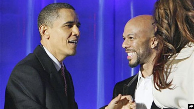 In this December 3, 2009 file photo, President Barack Obama greets rapper Common at the National Christmas Tree Lighting Ceremony in Washington, DC