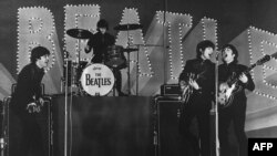 This photo taken on June 30, 1966 shows British band The Beatles, left to right, Paul McCartney, Ringo Starr, George Harrison and John Lennon, performing during their concert at the Budokan in Tokyo.
