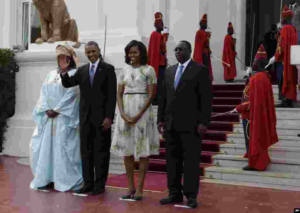 U.S. President Barack Obama poses for a picture with his wife Michelle Obama and Senegalese President Macky Sall and his wife Mariame Faye Sall, at the presidential palace in Dakar, Senegal, June 27, 2013.