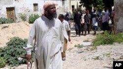 Muktar Robow, yahoze ar'umukuru w'umuhari al-Shabab, ari m'uburaruko bw'umurwa mukuru wa Somaliya, i Mogadishu.