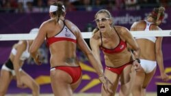 FILE - The United States' Kerri Walsh Jennings, right, and Misty May-Treanor react during the women's gold medal beach volleyball match against another U.S. team at the 2012 Summer Olympics, Aug. 8, 2012, in London.