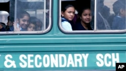 FILE - Kenyan students ride the bus to their school, Jan. 14, 2008.