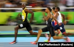 Jamaican sprinter Usain Bolt (in the lead) looks at the camera as he and other runners compete at the 2016 Olympics in Rio de Janeiro, Brazil. (Reuters Photo: Kai Pfaffenbach)