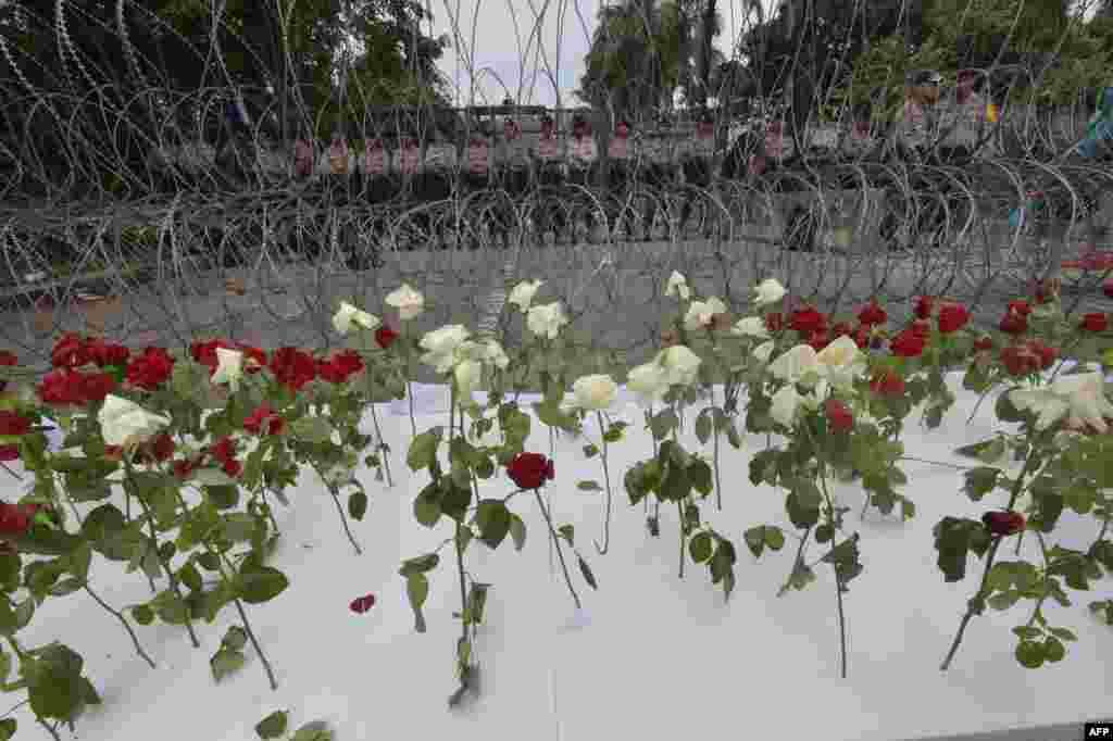 Indonesian policemen stand guard behind barbed wire and roses during the verdict for Jakarta governor Basuki Tjahaja Purnama, outside the North Jakarta court.