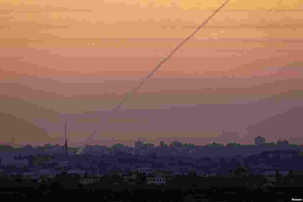 A smoke trail is seen as a rocket is launched from the northern Gaza Strip November 15