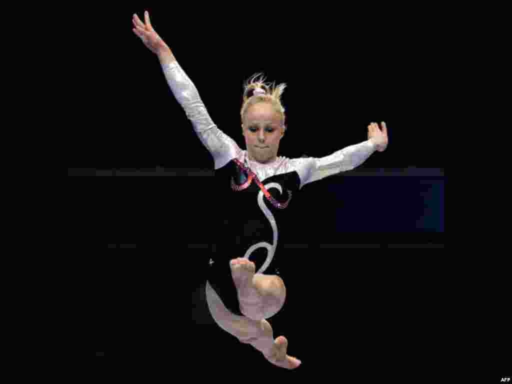 Sweden's Jonna Adlerteg performs on the balance beam during the women's qualifying of the Artistic Gymnastics World Championships in Tokyo, Japan, Friday, Oct. 7, 2011