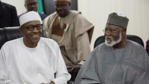 Nigerian former Gen. Muhammadu Buhari, left, and former Nigeria President Abdulsalami Abubakar, right, watch the announcement of presidential election results in Abuja, Nigeria, Tuesday, March 31, 2015.