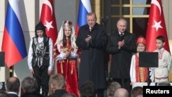 Turkish President Tayyip Erdogan, center left, and his Russian counterpart Vladimir Putin attend groundbreaking ceremony of the Akkuyu Nuclear Power Plant through videolink, at the Presidential Palace in Ankara, Turkey April 3, 2018.