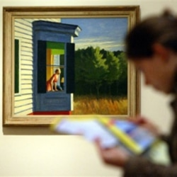 """A museum visitor stands in front of the painting """"Cape Cod Morning"""""""