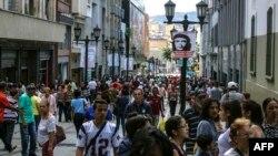 People walk along a pedestrian street in Caracas, Venezuela, Nov. 2, 2017.