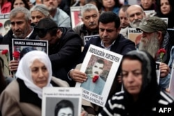 """Selahattin Demirtas (C), co-leader of Turkey's pro-Kurdish Peoples' Democratic Party (HDP), attends a gathering of """"Saturday Mothers"""" at Galata Sarai Square in Istanbul on October 31, 2015 on the eve of the country's general election."""