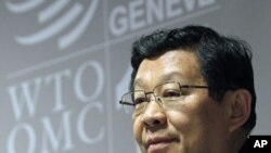 China's Minister of Commerce Chen Deming addresses a news conference at the 8th World Trade Organization Ministerial Conference in Geneva, December 15, 2011.