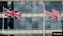 FILE - A British Union flag (L) and U.S. flag are seen flying in front of an office building in London, March 30, 2016. Post-Brexit relations between the two countries have been a matter of debate.