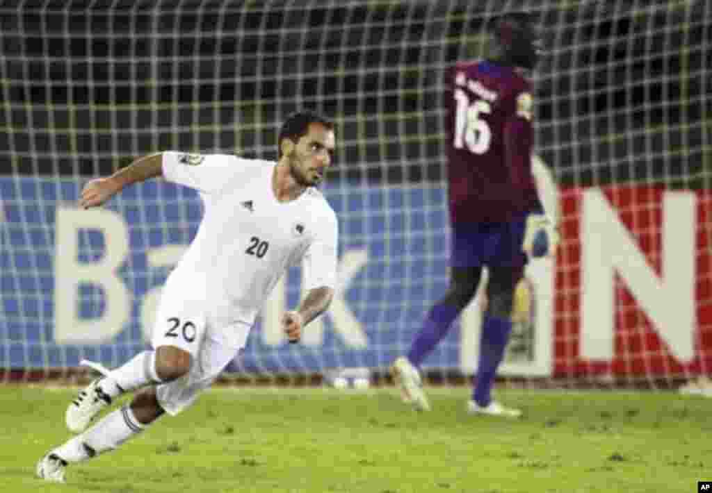 "Libya's Ihab Al Bouseffi celebrates after scoring a goal against Senegal during their African Nations Cup Group A soccer match at Estadio de Bata ""Bata Stadium"", in Bata January 29, 2012."