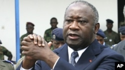 Ivory Coast's President Laurent Gbagbo attending an official funeral ceremony in Abidjan (File)