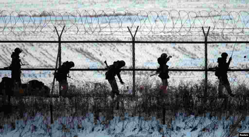 South Korean soldiers check military fences as they patrol near the demilitarized zone separating North Korea from South Korea, in Paju, north of Seoul, February 12, 2013.