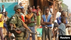 DRC soldiers, part of an African peacekeeping force, patrol along a street in Bangui, Feb. 12, 2014.