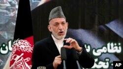 하미드 카르자이 아프가니스탄 대통령이, 18일 카불에서 열린 치안권 이양식에서 발언하고있다.