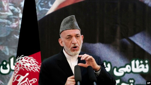 Afghan President Hamid Karzai speaks at a press conference during a ceremony at a military academy on the outskirts of Kabul, Afghanistan, June 18, 2013.