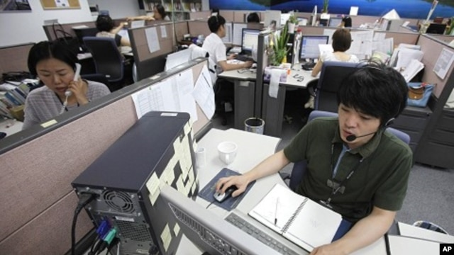 AhnLab Inc Customer Support team talk to customers on their phones at a call center in Seoul (file photo)