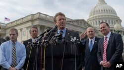 Sen. Rand Paul, R-Ky., center, joined by, from left, Rep. Jim Jordan, R-Ohio, Rep. Mark Sanford, R-S.C., Rep. Louie Gohmert, R-Texas, and Sen. Mike Lee, R-Utah, speaks about health care during a news conference on Capitol Hill in Washington, March 7, 2017
