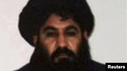 FILE- Mullah Akhtar Mohammad Mansour, Taliban militants' leader, is seen in this undated handout photograph by the Taliban. After days of widespread reports that he had been seriously wounded in a gunfight with rival militant commanders, the Islamist insurgency released a voice message from its chief to prove he is alive.