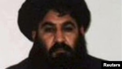 FILE - Mullah Akhtar Mansoor, leader of the Afghan Taliban, is seen in this undated handout photo from the Taliban.