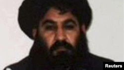 FILE - Mullah Akhtar Mohammad Mansoor, Taliban militants' new leader, is seen in this undated handout photograph by the Taliban. Unconfirmed reports suggest the leader was killed in a shootout in Quetta.