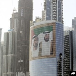 Images of Sheik Mohammed bin Rashid Al-Maktoum, UAE prime minister and ruler of Dubai, left, and Sheik Khalifa bin Zayed Al-Nahyan, UAE president, right, adorns a tower at Internet City, in Dubai (File Photo).